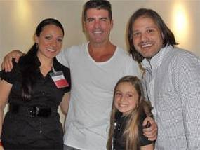 http://aselabar.files.wordpress.com/2011/02/heather-simon-cowell.jpg